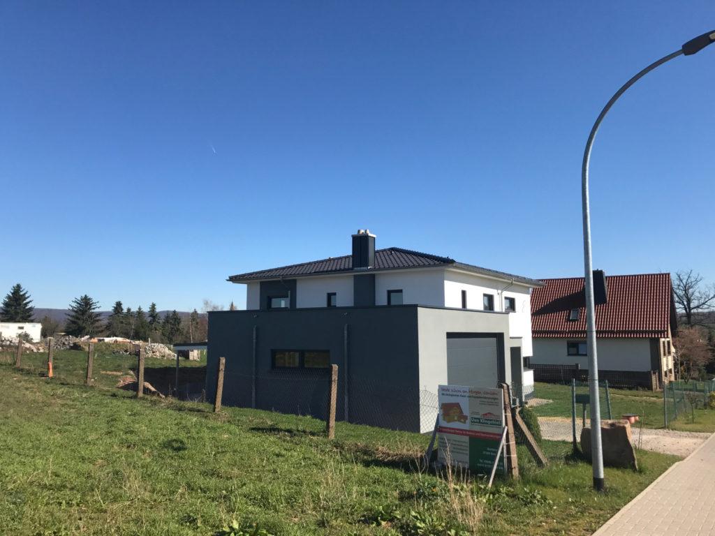 Modernes Haus in Holzrahmenbauweise Putzfassade
